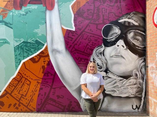 Councillor Sandra Duffy at  Amelia Earhart mural at the weekend
