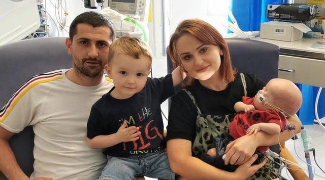 Reid McGlinchey Stewart along with mum Eireann, dad Sean and three-year-old brother Miller.