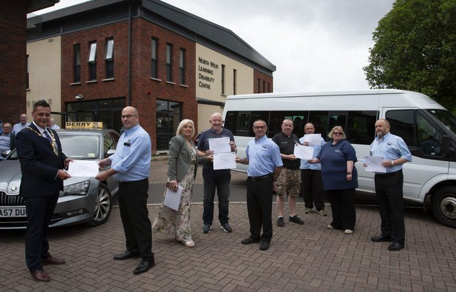 DISABILITY AWARENESS CERTIFICATES. . . . .The new Mayor of Derry City and Strabane District Council, Graeme Warke pictured presenting Destined-Derry Taxis Certificates of Achievement for Completing Learning Disability and Autism Awareness Training for Taxi Dispatchers and Drivers awards at the North West Learning Disability Centre on Tuesday morning. Accepting his award is Gerry Breslin, manager, Derry Taxis. Included from left are Caroline Oâ€TMHara, Facilitator, Thomas Starrs, Jim Kelly, Phil Thompson, Liam Duffy, Adere Darby, chair, Destined and Brian Lyttle. The interactive training course was designed to help managers and employers understand their responsibilities towards people with learning disabilities and autism.  (Photos: Jim McCafferty Photography)