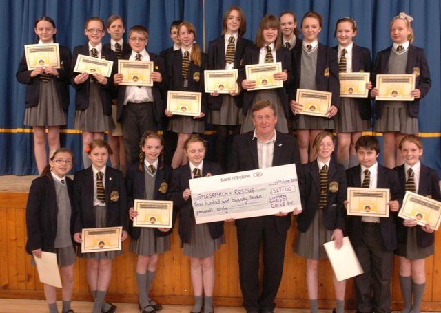 Pupils from Lumen christi college presenting a cheque for £327 to Danny Kelly, Foyle search and rescue the proceeds of a young enterprise project at the school. (2806SL08)