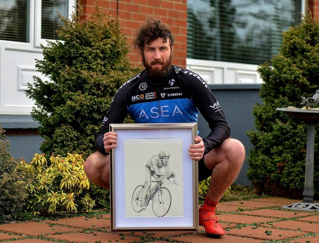 Danny Quigley, who will complete 10 ironman triathlons in 10 days, in memory of his late father, raising funds for suicide awareness pictured with a sketch of his dad. Photo: George Sweeney. DER2112GS - 003
