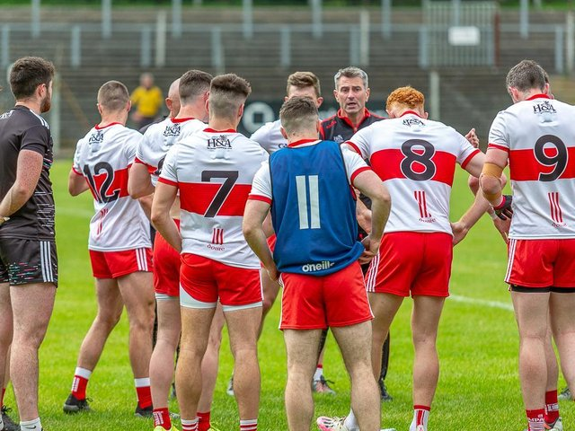 Rory Gallagher talks to his players during the second half water break against Limerick in Carrick-on-Shannon on Saturday. (Photo: Stefan Hoare)