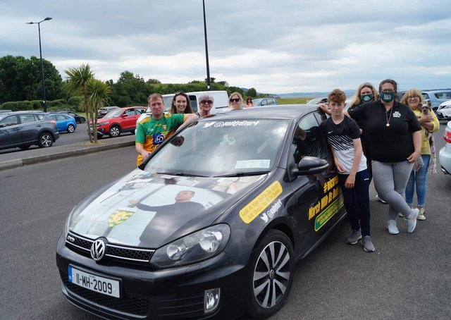 Ready to go: Paddy Diver, pictured with his family and fellow campaigners after handing out posters and stickers at Buncrana Shore Front on Sunday. Photo: Rory Kelly.