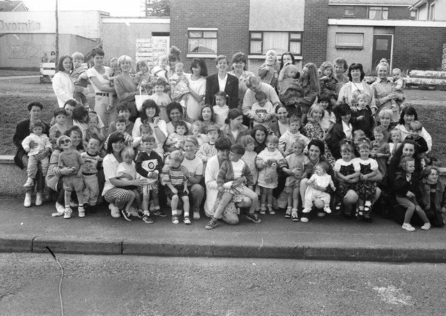 Parents and toddlers of the Top of the Hill community playgroup and the Derryview playgroup before leaving on a bus trip to Portrush.