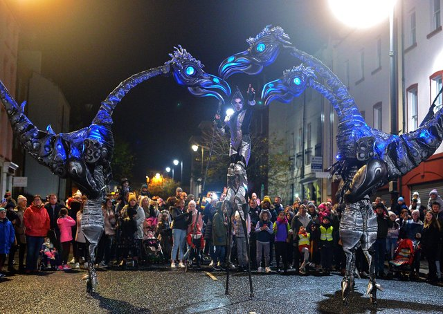 The giant Sarusus entertain the crowds at the Awakening on the Walls carnival in the city centre.  DER4419GS - 016