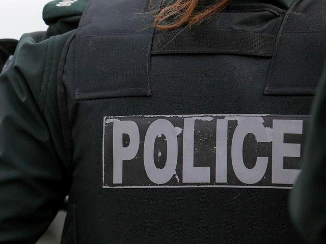 Police charge sixth person in connection with Tullyally riots.