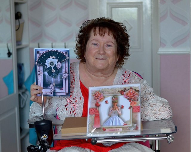 Mrs Linda Kivlehan pictured, in her home, with some of the greeting cards she made during the Covid 19 lockdown. DER2125GS - 001