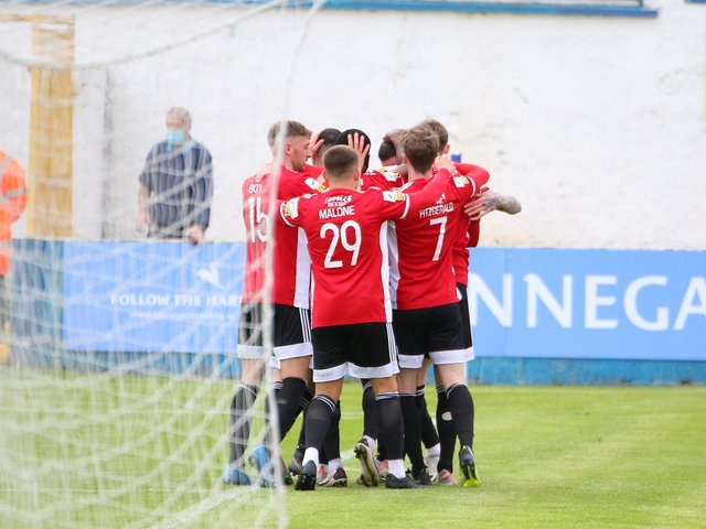 Derry City players celebrate Will Patching's stunning free-kick at the end of the first half. Photographs by Kevin Moore.