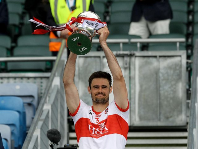 Derry captain Chrissy McKaigue lifts the Division Three trophy in Croke Park on Saturday after defeating Offaly. (Photo: Inpho\Lorraine O'Sullivan)