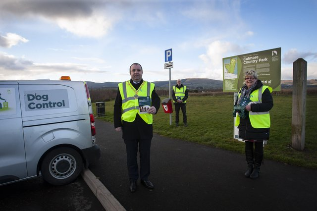 Councillor Brian Tierney pictured with Kieran Graham, DCSDC Dog Warden, and Councillor Angela Dobbins at Culmore Country Park recently to promote responsible dog ownership. (Photo: Jim McCafferty Photography)