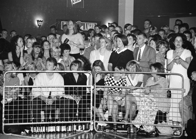 An anxious crowd awaiting the results of the 1996 Miss Derry competition in Squire's nightclub.