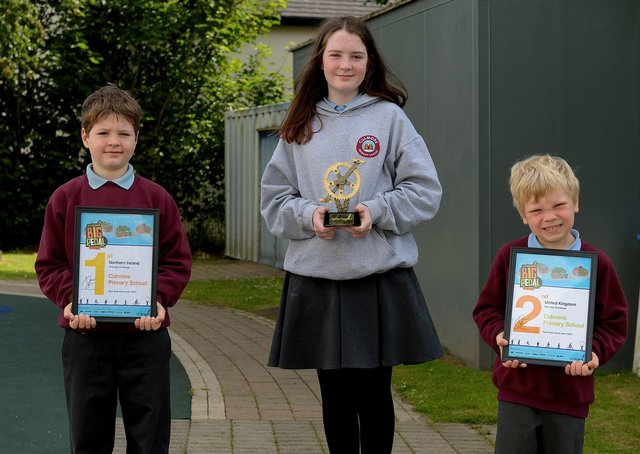 Culmore Primary School recently achieved first place in the Sustrans Northern Ireland region of 'The Big Pedal' one day challenge and second place overall in the UK. Pictured are pupils Pollan Doherty, Year 3, Hannah McLaughlin, Year 7, and Samuel McConaghie, Year 1, who accepted the awards on behalf of the school. DER2125GS - 007