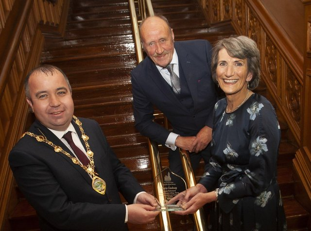 MARIE HONOURED. . . . .The Mayor of Derry City and Strabane District Council, Brian Tierney making a presentation to Marie Lindsay, former Principal, St. Maryâ€TMs College, Derry, on the occasion of her retirement and recognition of  her contribution and commitment to education. Included is Marieâ€TMs husband Collie. (Photos: Jim McCafferty Photography)