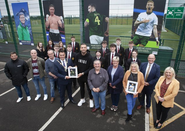LOCAL SPORTING HEROES. . . .  The Mayor of Derry City and Strabane District Council, Alderman Graham Warke pictured presenting Bright and Republic of Ireland international footballer Shane Duffy with a miniature copy of his portrait during Wednesdayâ€TMs Portrait Launch †̃Local Sporting Heroesâ€TM at Leafair Well Being Village. Included are Eddie Breslin, Housing Executive, sponsors, Peter McDonald, chair, Leafair Community Association, councillors Angela Dobbins and Sandra Duffy, Karen Mullan, MLA, Gerry McMonagle and students from St. Brigidâ€TMs College, Carnhill. (Photos: Jim McCafferty Photography)