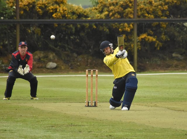 Fox Lodge's Jason Milligan drives to the boundary, during their game against Bready. Picture by Lawrence Moore
