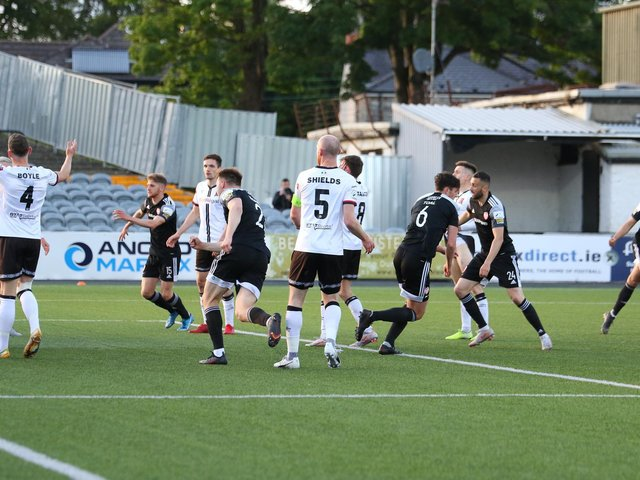 Eoin Toal races away to restart the game after finding the back of the net against Dundalk at Oriel Park. Photograph by Kevin Moore.