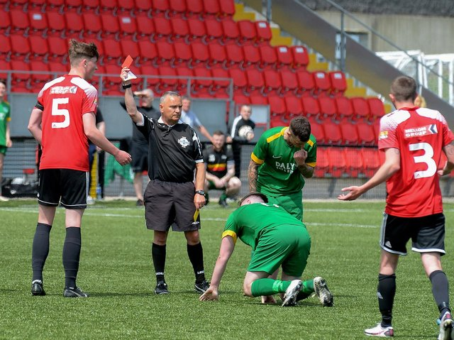 Referee Paul Doherty shows Maiden City's Jamie Robinson during the first half of the centenary McAlinden Cup Final on Sunday afternoon last. (Photo: George Sweeney). DER2126GS - 005