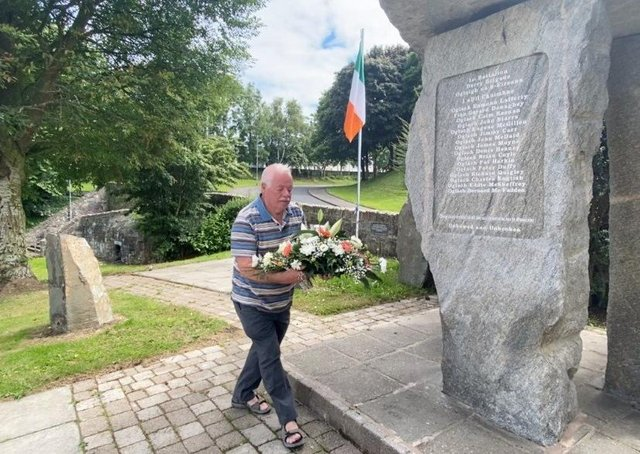 Eugene Lafferty, brother of Vol. Eamonn Lafferty lays a wreath during the commemorations. Eamonn was shot dead during a gun battle with the British Army in Creggan on August 18, 1971.