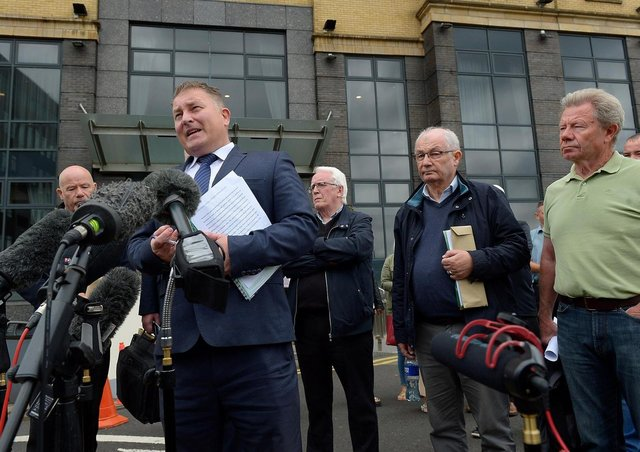 Solicitor Ciaran Shiels with Bloody Sunday relatives  outside the City Hotel on Friday morning after the PPS announcement that Soldier F will not stand trial. Photo: George Sweeney / Derry Journal.  DER2126GS – 161