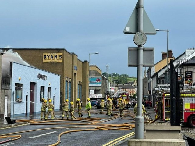 Firefighters tackling the blaze on Sunday. Picture posted by Daniel McCrossan MLA who owns a pub across the street.