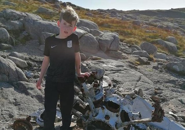 Shae with the wreckage of a Sunderland Bomber from World War Two on the slopes of Croaghmore.