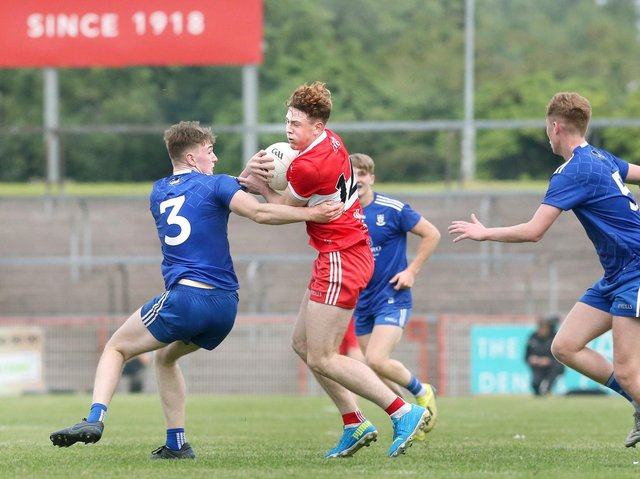 Derry's Lachlan Murray takes on Monaghan's Louis Kelly of Monaghan during the Friday's Ulster Minor Football Championship Final in Healy Park.