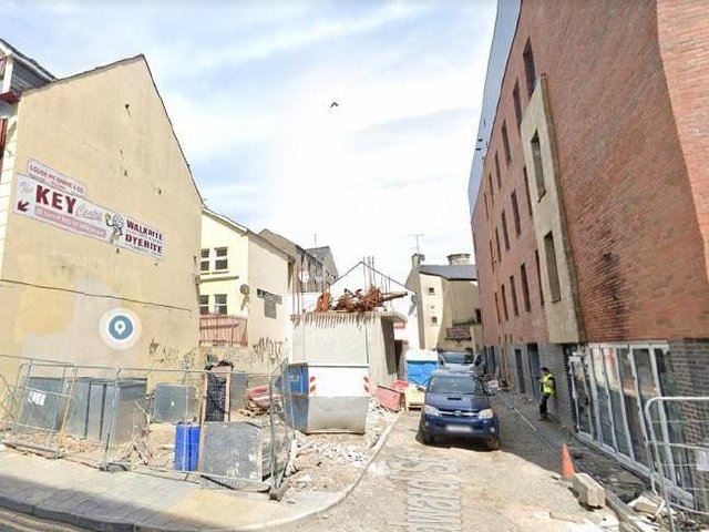The 22 flats will be located in the rear laneway of the Strand Hotel building.