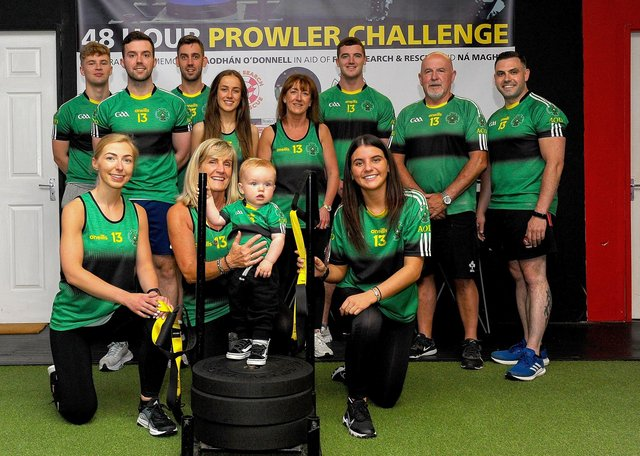 Members of the O'Donnell family and friends pictured on Thursday last at the launch of the 48 Hour Prowler Challenge in memory of Aodhán O'Donnell and in aid of Foyle Search and Rescue at the Uturn Fitness centre, Whitehouse Road. Included in the photograph is Uturn Fitness proprietor Danny Glenn. DER2127GS – 022