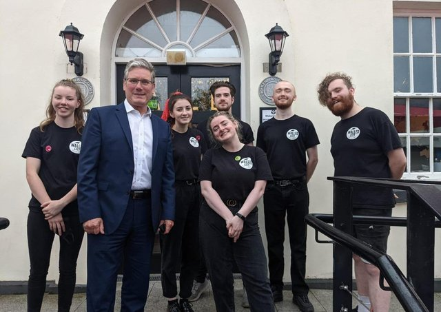 Labour leader Keir Starmer with staff from the Walled City Brewery.