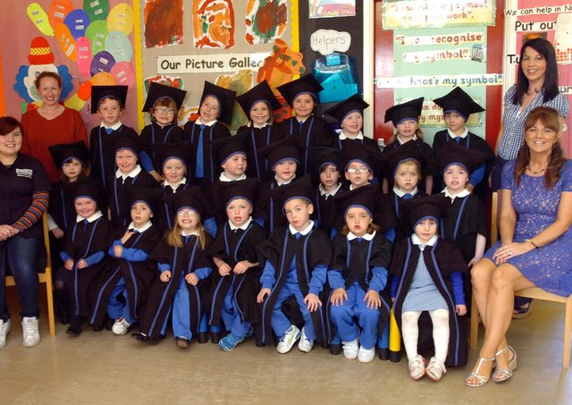 Children from Termoncanice Primary School Nursery pictured at their graduation ceremony with staff members, seated from left, Lauren McLaughlin and Ann Marie Diamond, teacher. Standing are Hilary Hargan, left, and Nuala McDermott. (3105PG69)
