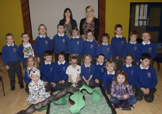 Some of the P2, 3 & 4 pupils who took part in the recent Harvest Assembly at Bready Jubilee Primary School. Included are Luanne McElwee, Principal, and Yolanda Scobie, teacher. INLS4413-103KM