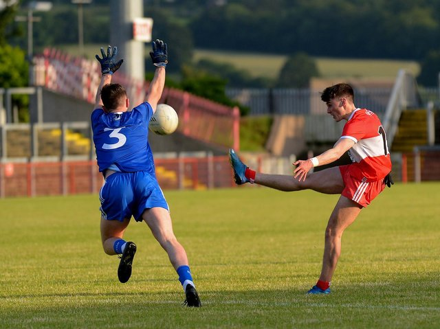 Monaghan's Thomas McPhillips attempts to block a shot from Derry's Conor McAteer during the Ulster Under 20 match on Friday night. (Photo: George Sweeney)