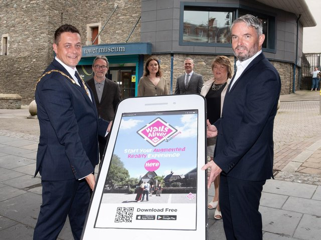 The Mayor Graeme Warke and Visit Derry manager Odhran Dunne launching the Walls Alive App.