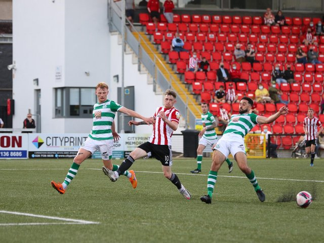 Derry sub, Jamie McGonigle attempts to get to this cross under pressure from Roberto Lopes and Liam Scales