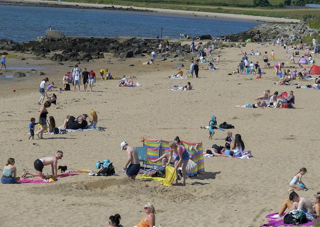 Lady's Bay on Buncrana's Shore Front, on Saturday afternoon last. People from Derry flocked to Inishowen's beaches to enjoy the fine weather. Photo: George Sweeney. DER2128GS – 045