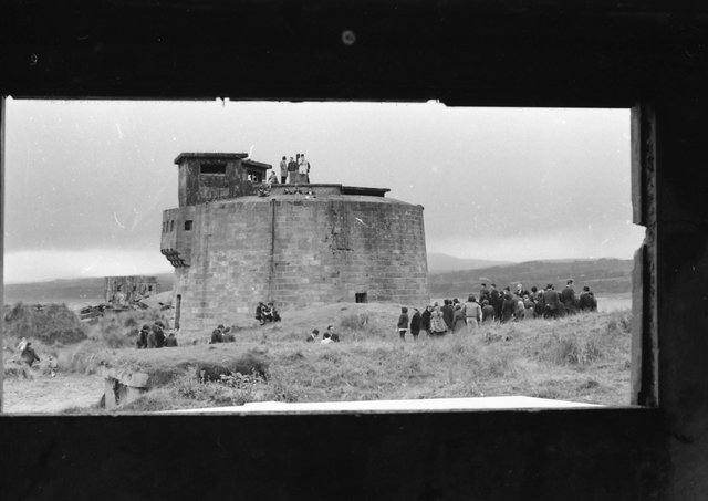 A protest at the Martello tower in Magilligan near the British army camp were local internees were held. The photograph has been taken through a loophole in a nearby fortification.
