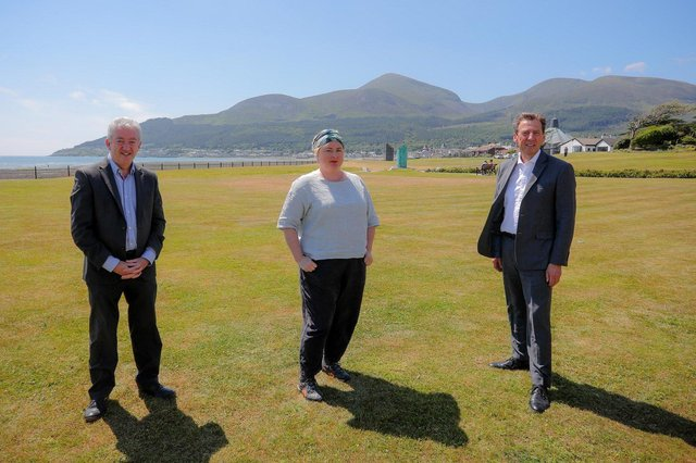 PIC SHOWS: Actress Siobhán McSweeney; with John McGrillen, Chief Executive of Tourism NI (left); and Shane Clarke, Tourism Ireland's Director of Corporate Services, Policy & Northern Ireland (right), during filming for Exploring Northern Ireland with Siobhán McSweeney, in Newcastle, Co Down.