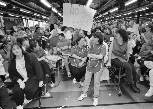 The scene when workers at the crisis torn Coats Viyella factory at Maydown ceased production during a management meeting.